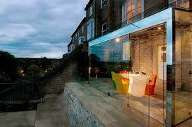 Home Interiors:Elegant Glass House Extension With Colorful Chair And  Natural Stone Floor Ideas Elegant