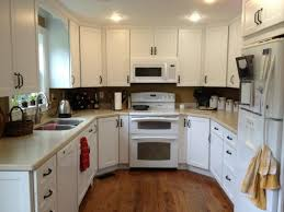 lighting for small kitchen. image of fancy recessed lighting kitchen ideas above white home appliances including slide in induction range for small