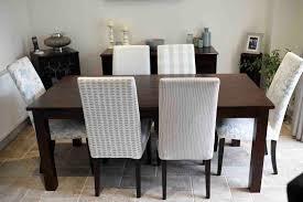 dark wood dining table and six multiyork chairs