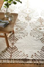 cream rug ethnic pattern white and beige flatweave large john lewis area rugs gy uk under plush for living room ikea s