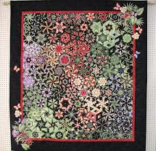 400 best Kaleidoscope quilts images on Pinterest | Black quilt ... & This One Block Wonder quilt has added appliques made from the motifs of the  original fabric Adamdwight.com