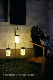 interesting solar power outside lighting solar powered mason jar lights on hooks awesome outdoor lighting idea