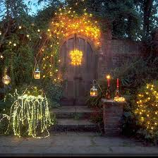 outdoor fairy lighting. garden bushes decorated with fairy lights l outdoor christmas lighting ideas 2013 photo t
