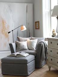 reading area with blankets and pillows makes for a comfortable area to snuggle into