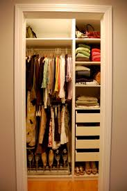 closet organization idea for small master bedroom with clothes rack and small drawers