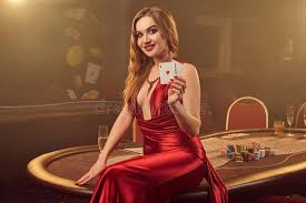 Close-up Shot Of A Beautiful Woman Posing Against A Poker Table In Luxury  Casino. Stock Photo - Image of makeup, brunette: 149886832