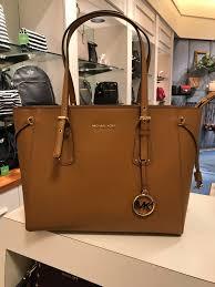 Von Maur Designer Handbags Michael Kors Voyager Multi Functional Medium Color Acorn