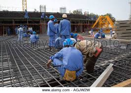 workers working on rebar reinforced concrete foundations floor base on a building construction site in abu rebar worker
