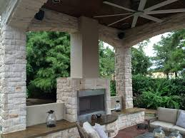this houston outdoor sitting area contains a gas fireplace with bench seating an outdoor ceiling