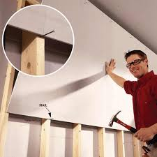 solo drywall hanging use this diy tip to hang drywall by yourself