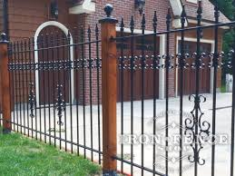 decorative metal fence post. Wrought Iron Fence With Add-on Decorations Mounted On Wood Posts Decorative Metal Post C