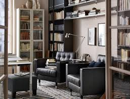 shelving furniture living room. a living room with two dark leather chairs and shelving furniture e