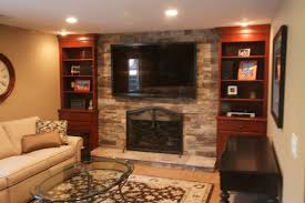 ledge stone fireplace tv installed over existing brick fireplace custom bookcases were added to
