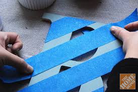 diy gift ideas applying painter s tape to decorated wooden letters