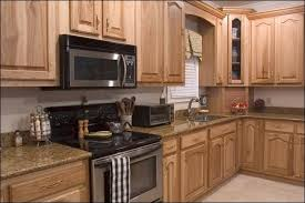 nice hickory cabinets with marble countertops at