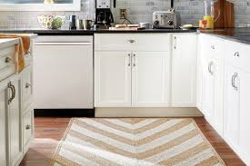 for a long or galley style kitchen choose a runner that will leave at least a few inches of floor between the edge of the rug and the toe kick