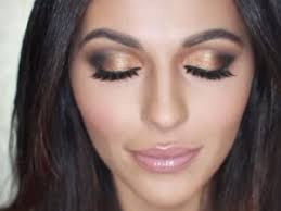 the black and gold smokey eye is a clic look for festive occasions