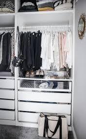 Fantastic walk in closet features an Ikea Pax Closet System boasting