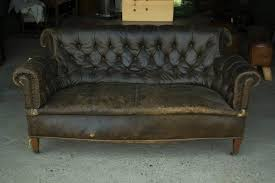 vintage leadther chesterfield sofa on caster vintage item please see images detail of wear
