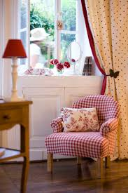 Whimsical Raindrop Cottage - Red gingham chair would go perfect in my  living room!