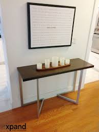 console table design transforming that converts to dining wooden floor white wall rectangular shape brown