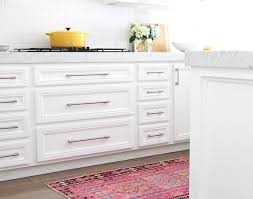 white cabinet handles. White Kitchen With Pink Accents Features Shaker Cabinets Adorned Ikea Vinna Handles Paired Carrera Marble Countertops And A Subway Cabinet U