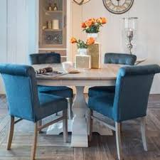 round extendable dining table is remended putney chanti upholstered dining chair luxury seating with wooden legs
