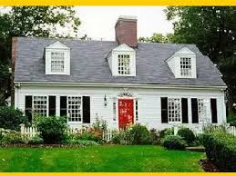 cape cod style with red door and black shutters dream home