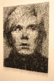 this fantastic portrait of andy warhol is by augusto esquivel the artist uses ons suspended