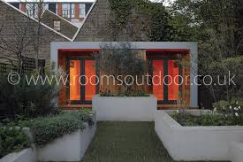 outdoor garden office. outdoor rooms with sleek lines softened by subtle planting the garden office