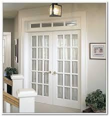 image of french doors interior bedroom with chandelier