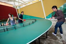 this giant round ping pong table takes the game to a whole new level of awesomeness