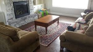 i d like there to be a large rug in the living area so kids can comfortably play on the floor etc