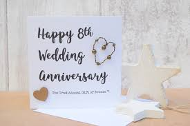 with the text happy 8th wedding anniversary the traditional gift of bronze blank inside for you