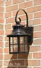 cleaning up the outside of our house by spray painting the light fixtures flanking our garage