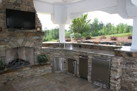 luxury outdoor kitchens fireplace