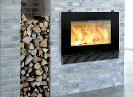 contemporary wood burning fireplace designs with gray brick wall