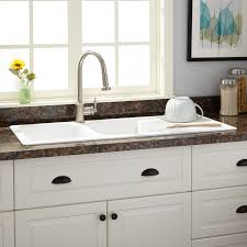 image of stainless steel sink with drainboard white