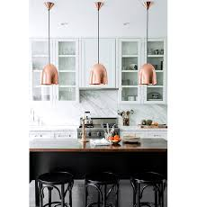 white kitchen with copper pendant lights