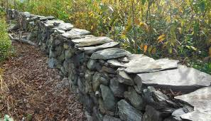 above another stone wall in litchfield ct exhibiting fieldstone capstones