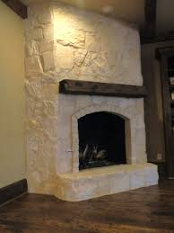 This fireplace received an Austin stone facelift. Designer Susan Mock  selected a sample of limestone