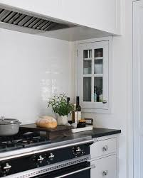 Put a French range in a range alcove with side wall niches and ...