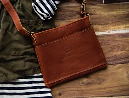 this super cute slim full grain leather purse with a nice long cross strap is the olivia this would be the perfect bag to take along on vacation