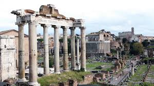 famous ancient architecture. Roman Forum - Ancient Architectural Monuments In Rome, Italy. Archeological  Dig And Tourists Destination. Famous Travel Attraction. People Walking. Famous Architecture