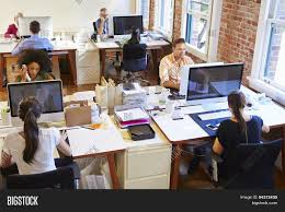 wide angle view busy design office. Modren Wide Wide Angle View Of Busy Design Office With Workers At Desks In T