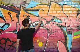 his neck paints colorful graffiti