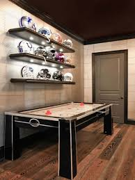 cool couches for man cave. With Three Tvs, A Comfy Couch, Shelves Of Helmets And An Air Hockey Table, This Great Space By KDS Interiors Shows That Man Caves Don\u0027t Need To Be Massive Cool Couches For Cave