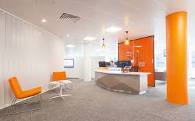 office orange. Foyer In London Offices With Unusual Faceted Reception Desk Backpainted Glass Backdrop, Orange Seating Office