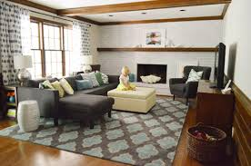 stylish and colorful living room with navy blue furniture graphic pillows and rug wood