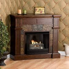 exquisite corner natural gas fireplace ventless with round mantel clocks aside single red rose arrangement in